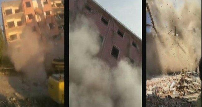 Attığı taşla 5 katlı binayı yıktı