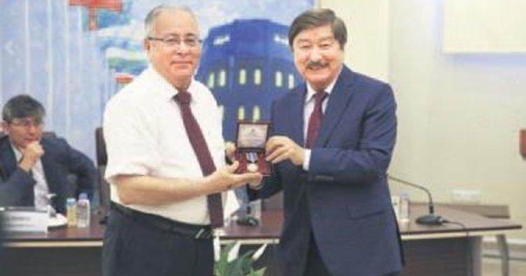 Türksoy'dan madalya töreni ve konferans