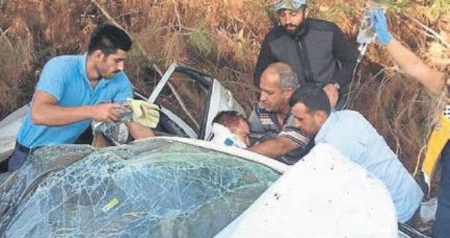 Takla atan araçtan yaralı kurtuldular